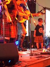 My Grandson getting up for his first performance at the Glengarry Highland Games! He even tried his shuffle step and his dance teacher was entertaining on stage as well.