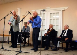 Rene Trottier and Hugh Allan MacMillan with their group play a few tunes.